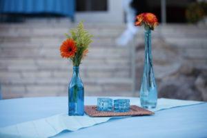 Teal Repurposed vases with wild flowers wedding